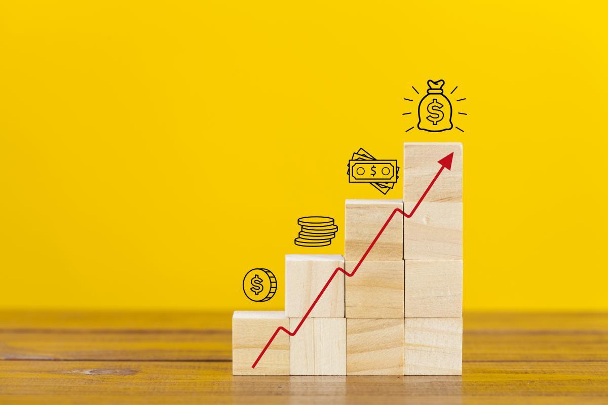 upward-trending-pay-chart-on-yellow-background