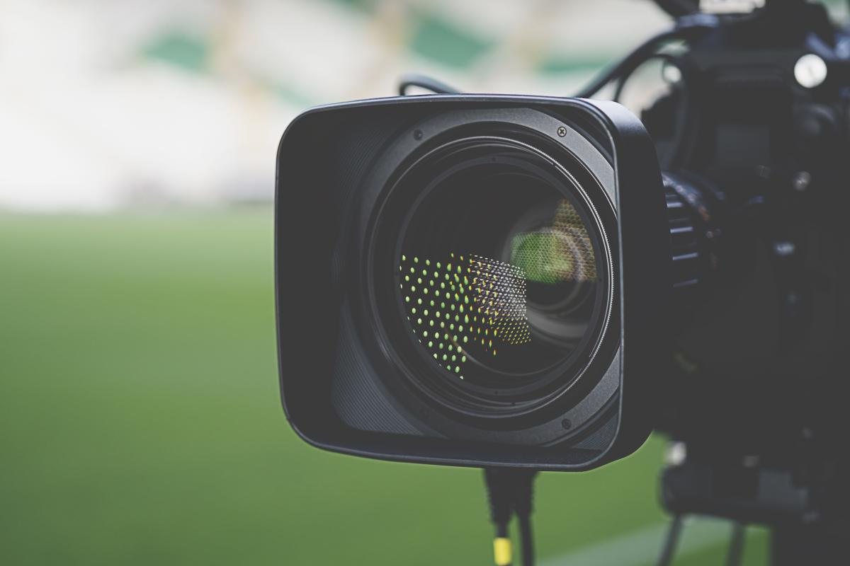 tv-news-camera-on-green-background