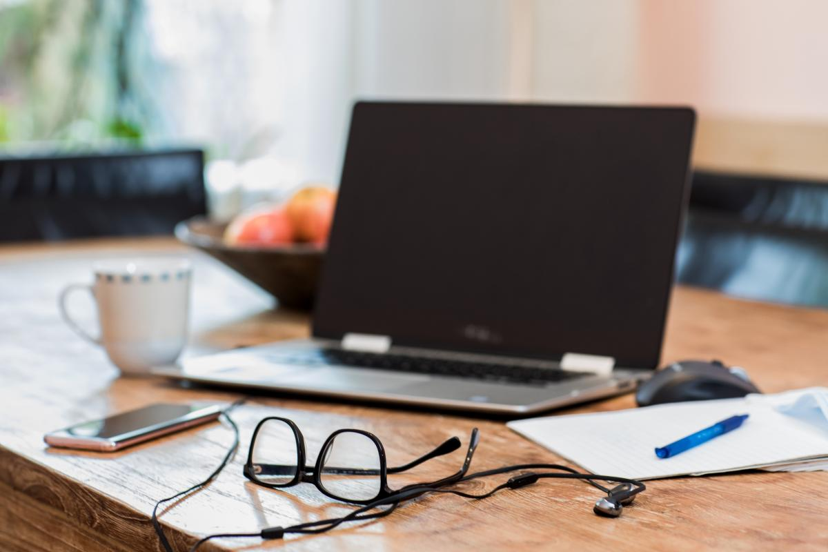 phone-headphones-and-laptop-setup-for-online-meeting