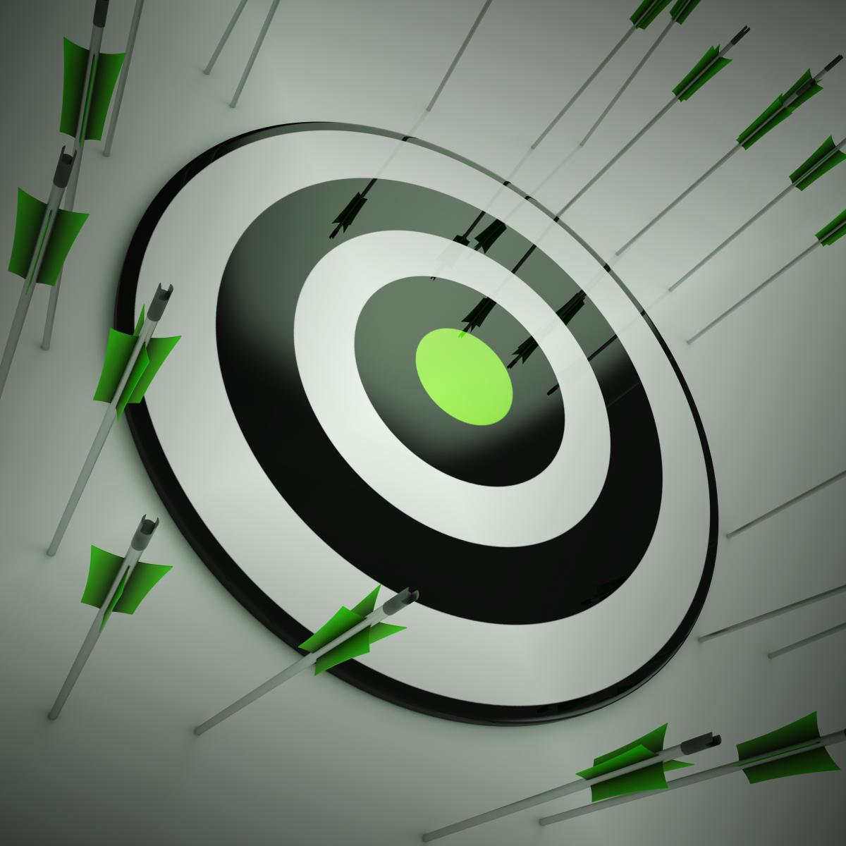 black-and-white-archery-target-with-missed-green-arrows