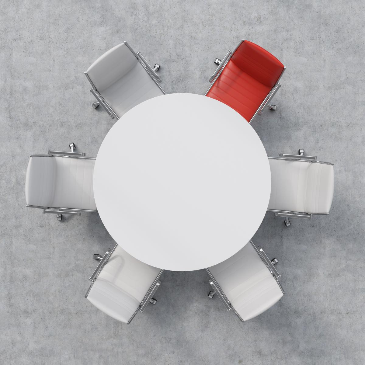 overhead-view-of-white-table-with-five-white-chairs-and-one-red-chair