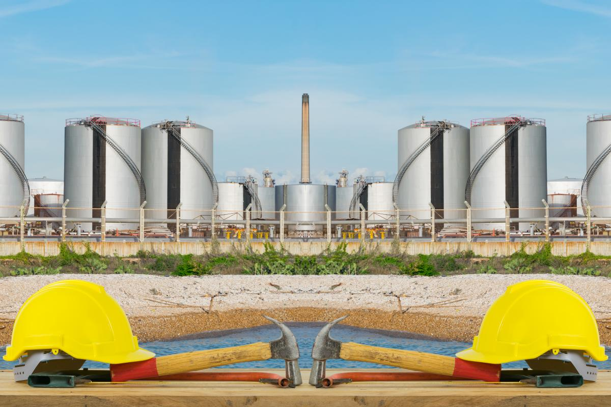 symmetrical-photo-with-yellow-hard-hats-and-oil-tanks