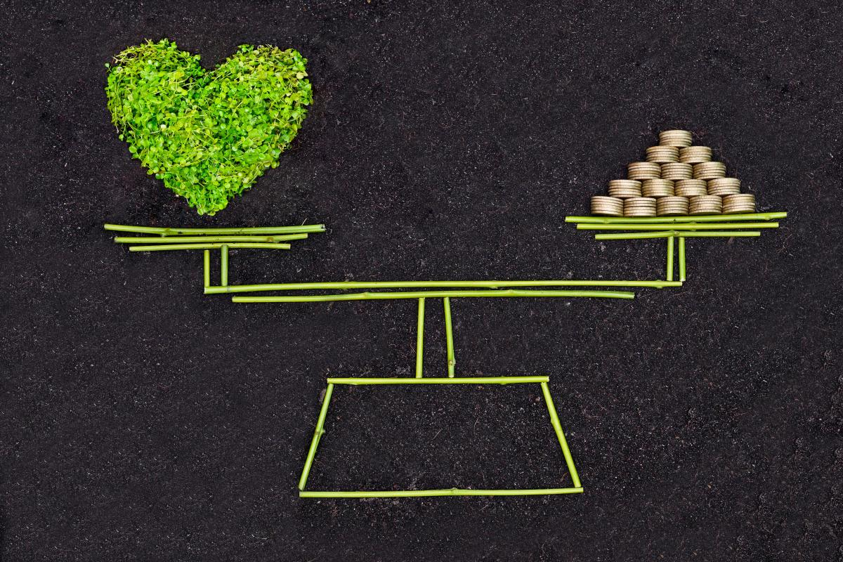 scale-balancing-green-heart-and-gold-coins