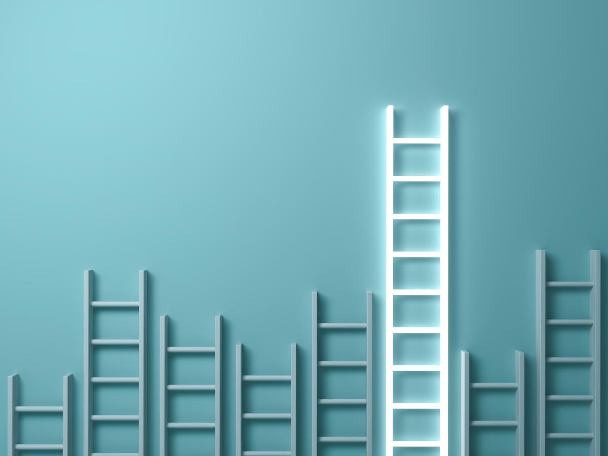 various-sized-ladders-against-blue-background