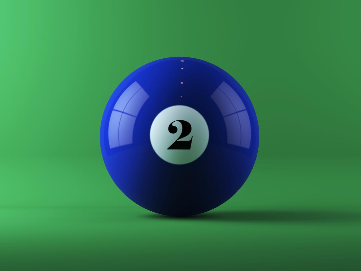 blue-billiard-ball-on-green-background