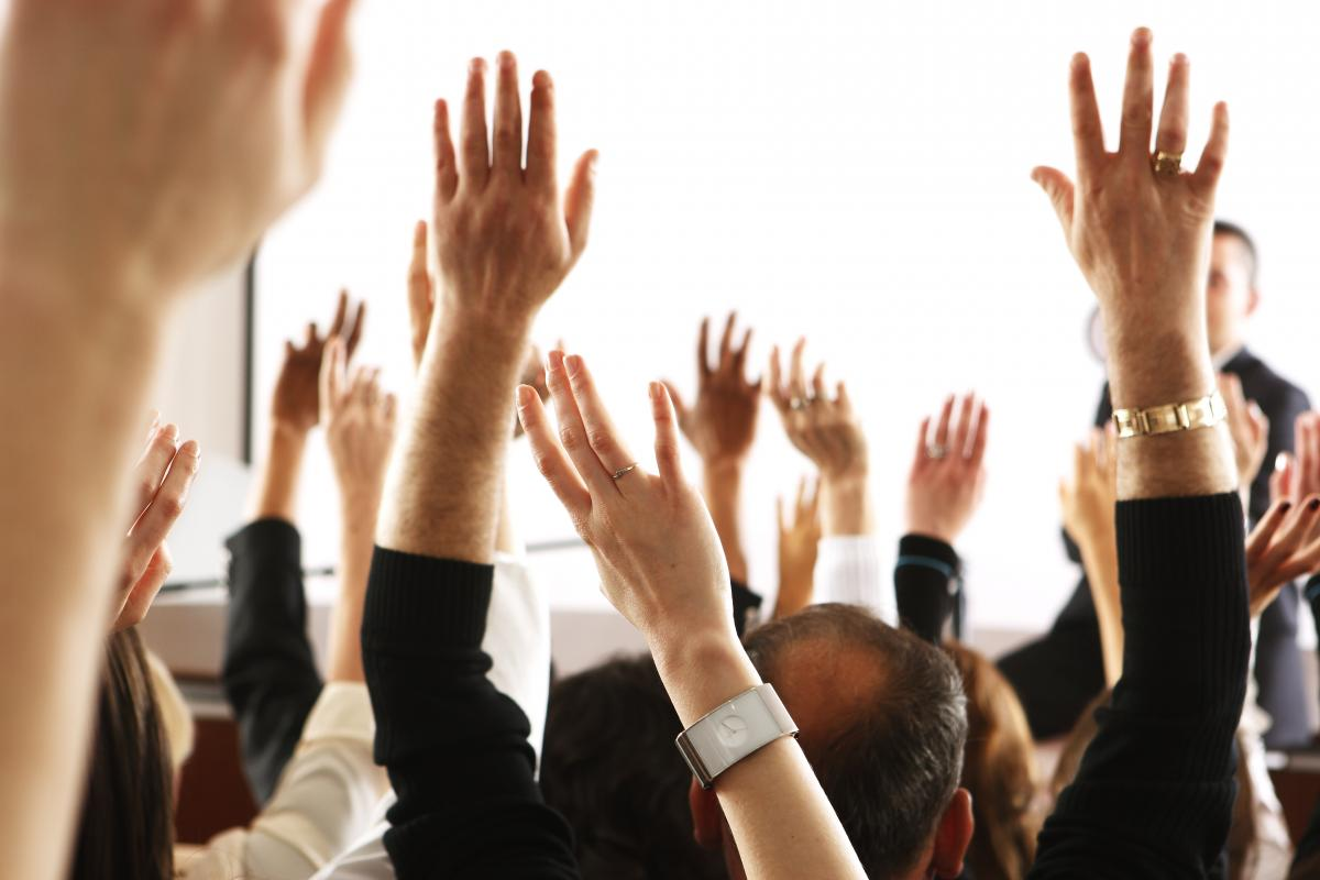 raised-hands-in-meeting